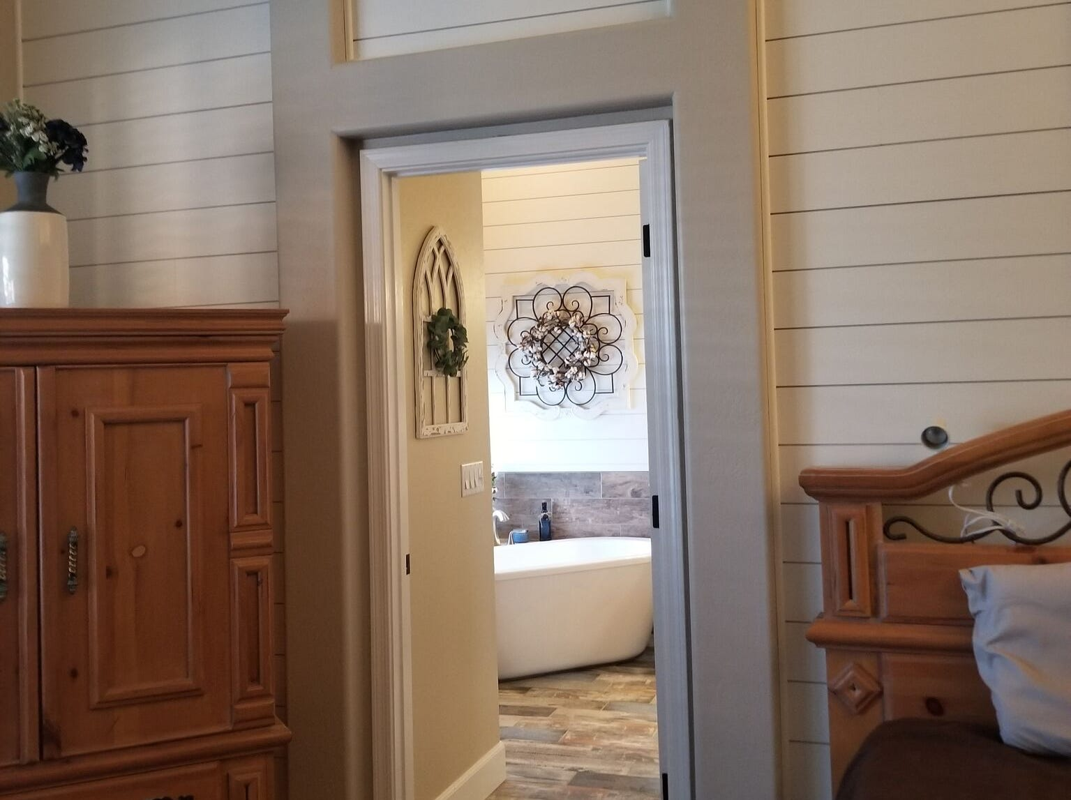 Shiplap was added to a bedroom wall and carries into the master bathroom.