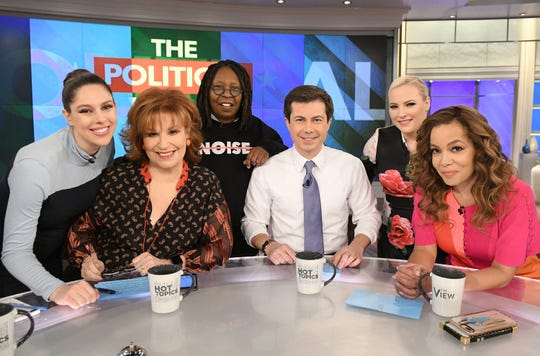 """Democratic presidential candidate Pete Buttigieg appears on """"The View"""" on Jan. 31, 2019. Abby Huntsman (from left), Joy Behar, Whoopi Goldberg, Meghan McCain and Sunny Ostin flank the candidate."""
