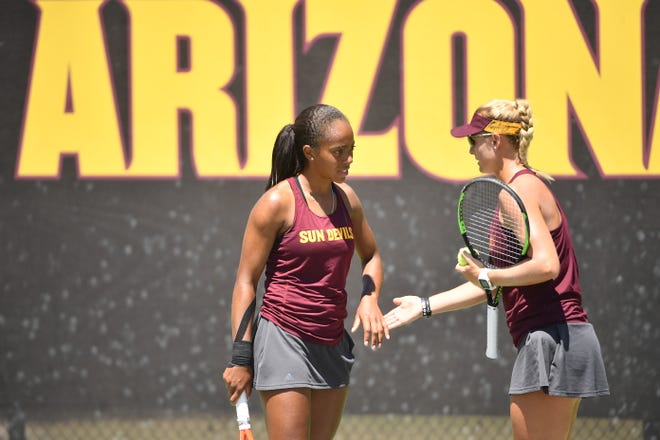 ASU's Lauryn John-Baptiste, left, and Ilze Hattingh are ranked a school high No. 1 nationally in doubles by the Intercollegiate Tennis Association.