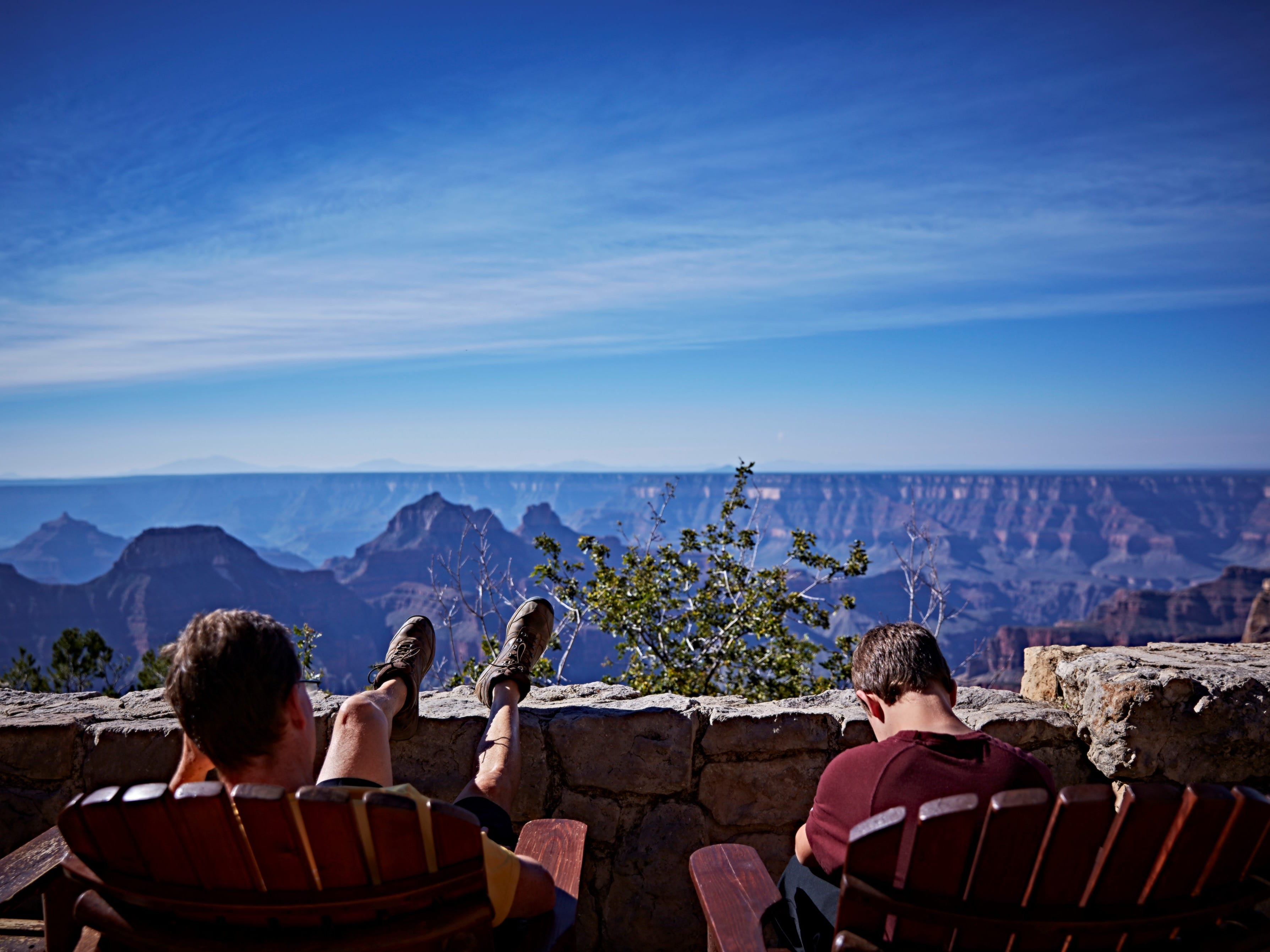 Pull up an Adirondack chair and enjoy the view from the patio of the Grand Canyon North Rim Lodge.