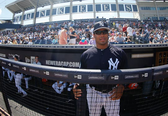 Seahawks quarterback Russell Wilson looks on from the Yankees dugout during a spring training game on March 15.