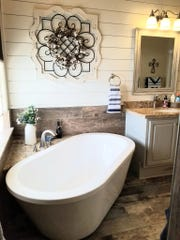 The renovated master bathroom is a relaxing rustic country space.