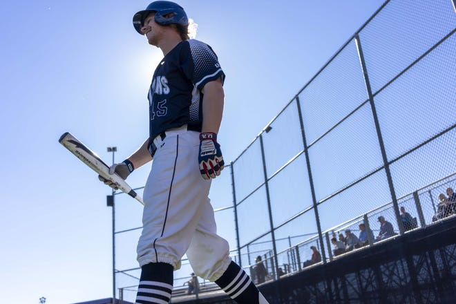 Cactus Shadows outfielder Peyton McGregor walks to the plate for an at-bat March 15, 2019.