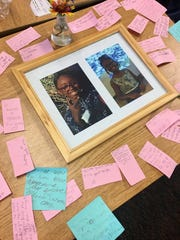 Summer Bell Brown's classmates voted to keep her desk where it was. Her friends write to her on sticky notes.