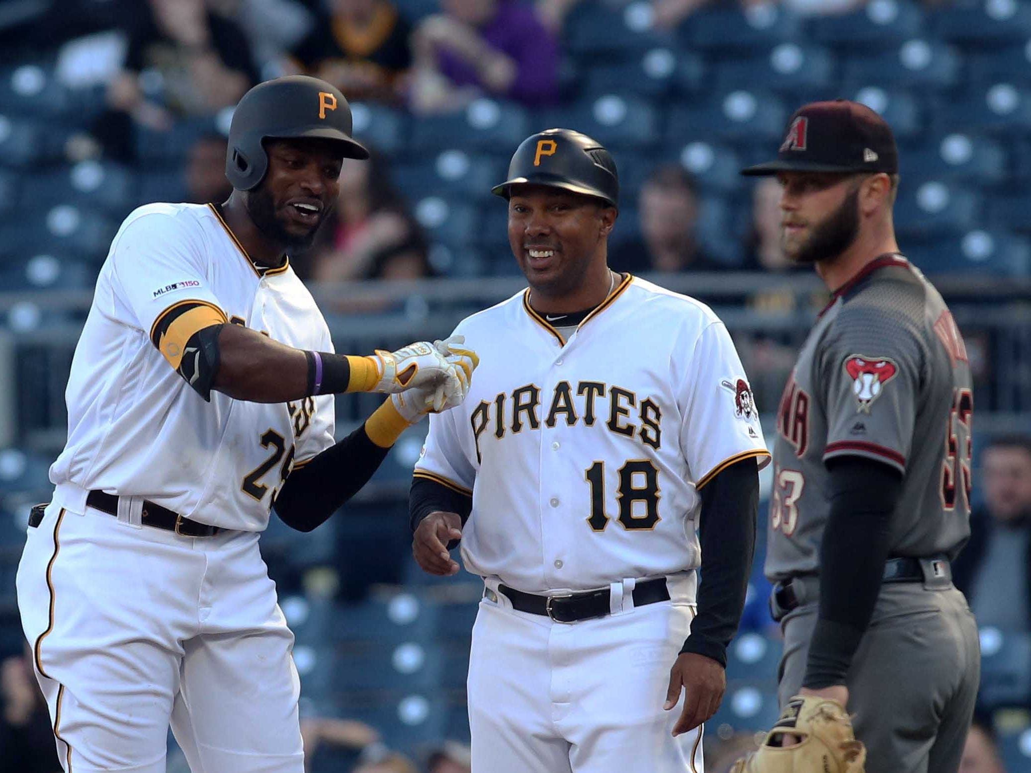 Apr 22, 2019; Pittsburgh, PA, USA;  Pittsburgh Pirates right fielder Gregory Polanco (25) demonstrates his swing to first base coach Kimera Bartee (18) after Polanco recorded his fist hit of the season during the first inning after being activated from the injured reserve list against the Arizona Diamondbacks at PNC Park.