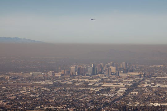 A heavy layer of pollution is visible from Dobbins Lookout at South Mountain Park in Phoenix.