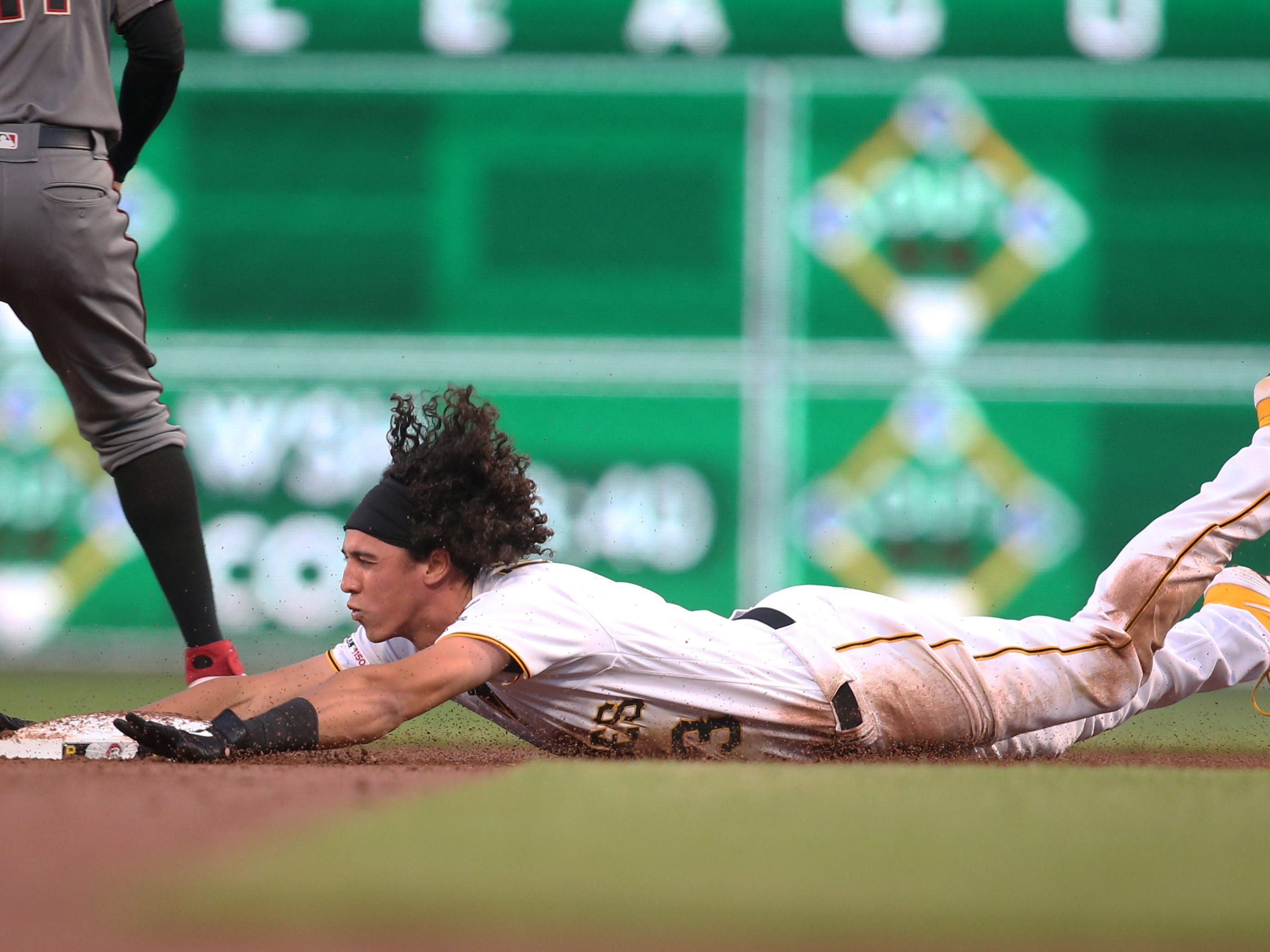 Apr 22, 2019; Pittsburgh, PA, USA;  Pittsburgh Pirates shortstop Cole Tucker (3) slides into second base with a double against the Arizona Diamondbacks during the second inning at PNC Park.
