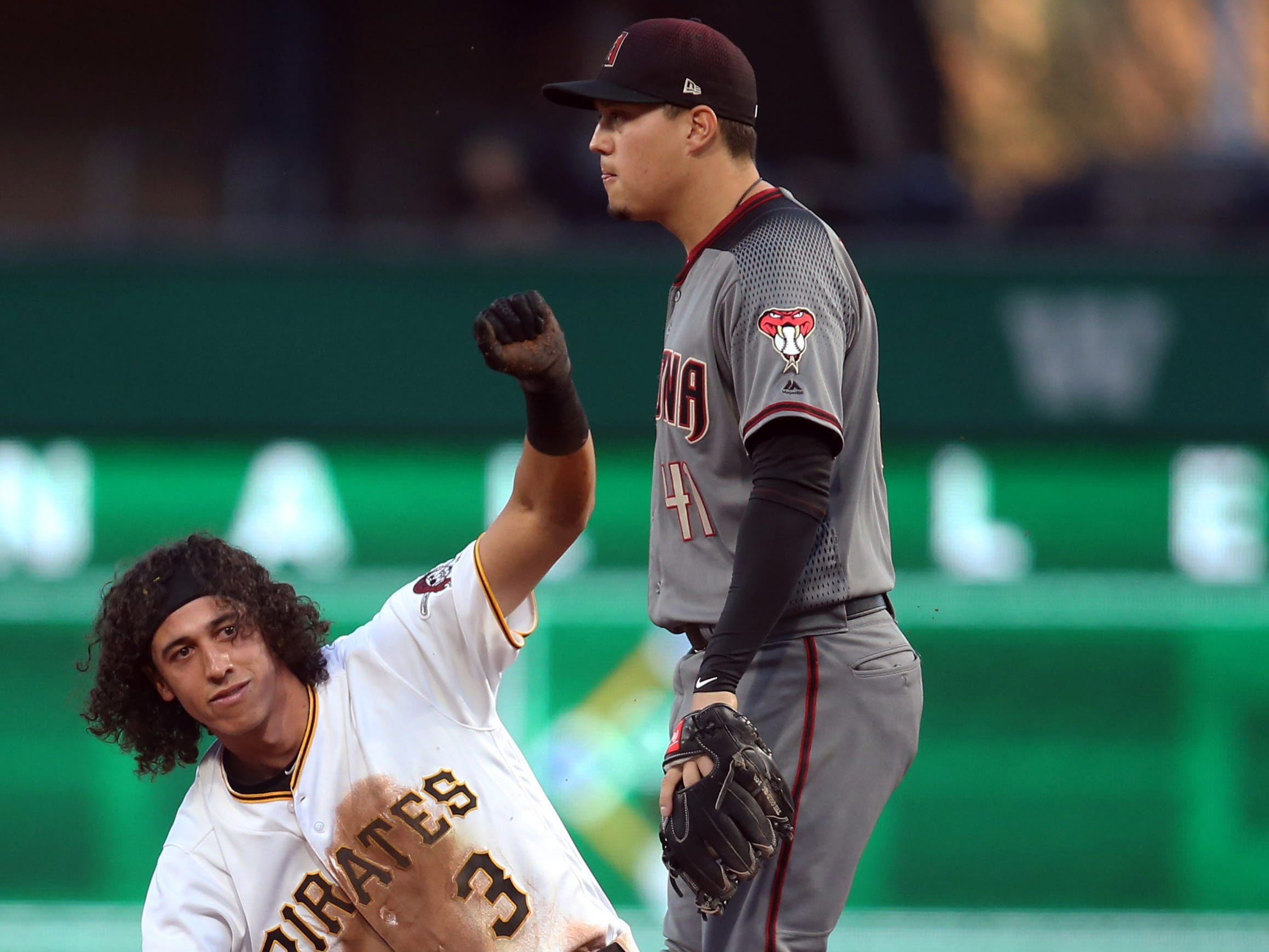 Apr 22, 2019; Pittsburgh, PA, USA;  Pittsburgh Pirates shortstop Cole Tucker (3) reacts at second base after hitting a double against the Arizona Diamondbacks during the second inning at PNC Park.