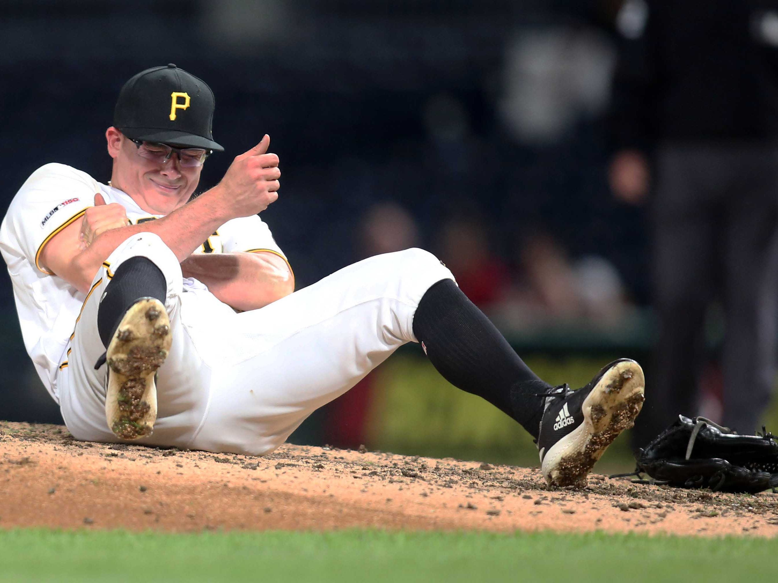 Apr 22, 2019; Pittsburgh, PA, USA;  Pittsburgh Pirates relief pitcher Nick Burdi (57) grabs his bicep after suffering an injury while pitching against the Arizona Diamondbacks during the eighth inning at PNC Park.