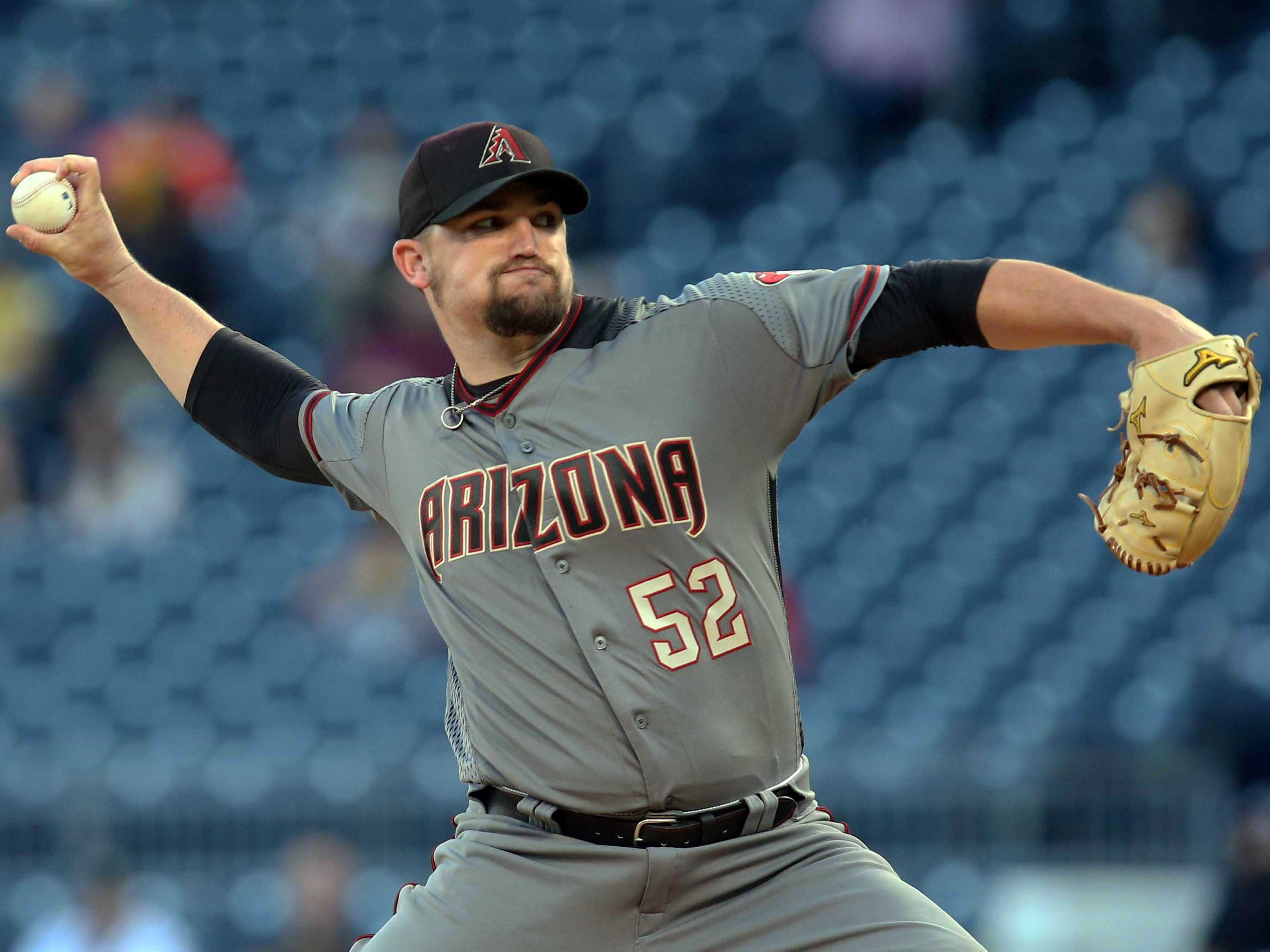 Apr 22, 2019; Pittsburgh, PA, USA;  Arizona Diamondbacks starting pitcher Zack Godley (52) delivers a pitch against the Pittsburgh Pirates during the first inning at PNC Park.