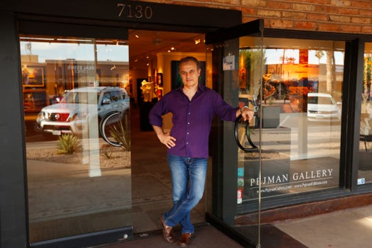 Bob Pejman poses outside his gallery in Scottsdale on April 11, 2019.
