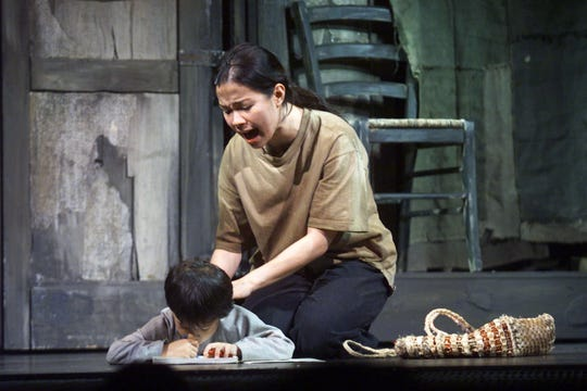 "Lea Salonga plays Kim and Regine Salcedo is Tam in ""Miss Saigon,"" performed on Sept. 28, 2000, at Manila's Cultural Center of the Philippines."