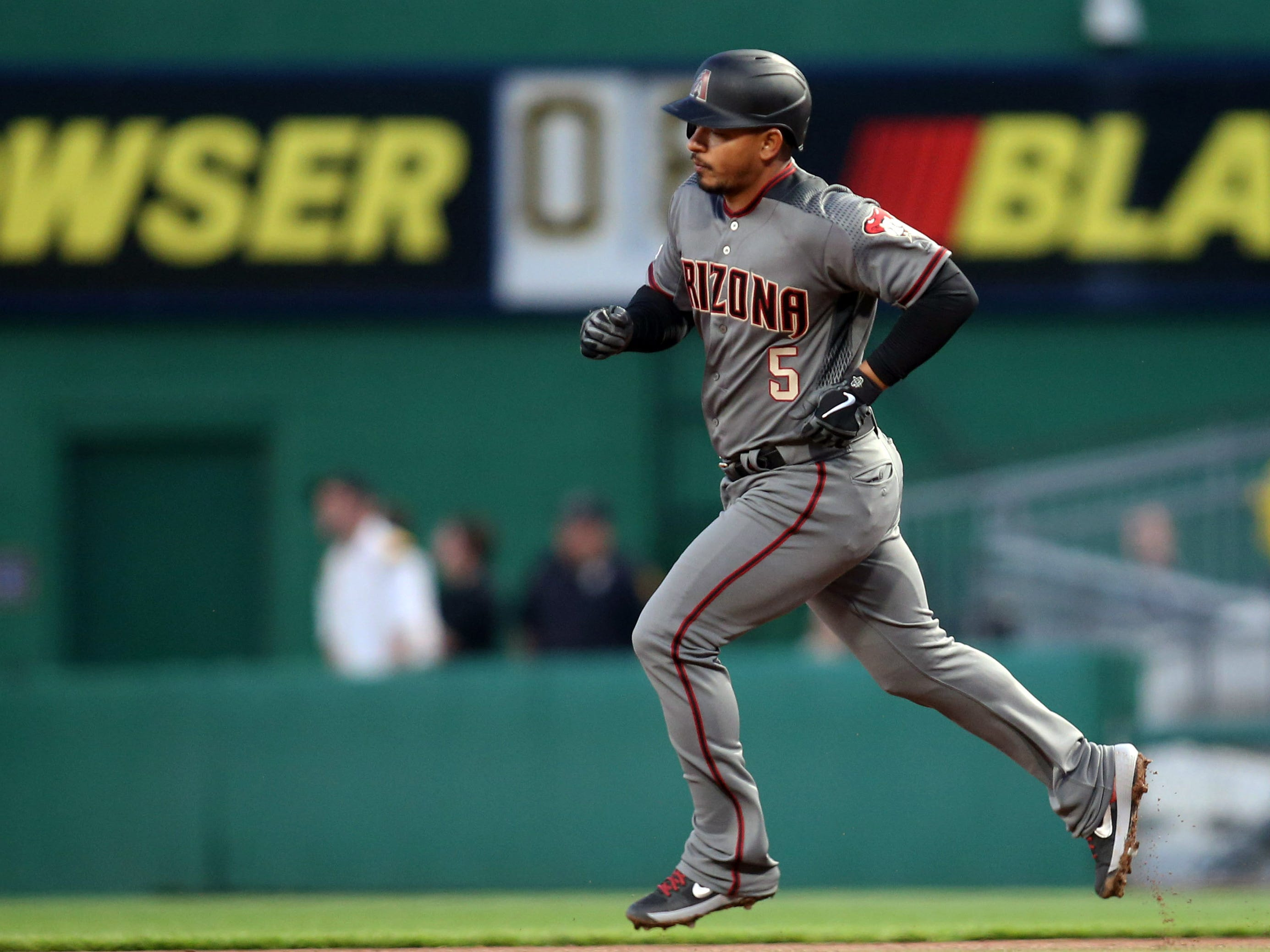 Apr 22, 2019; Pittsburgh, PA, USA;  Arizona Diamondbacks third baseman Eduardo Escobar (5) circles the bases on a solo home run against the Pittsburgh Pirates during the third inning at PNC Park.