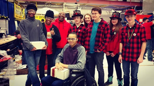 Members of FIRST Robotics teams Dynomite and Da MOOse pose for a group photo.