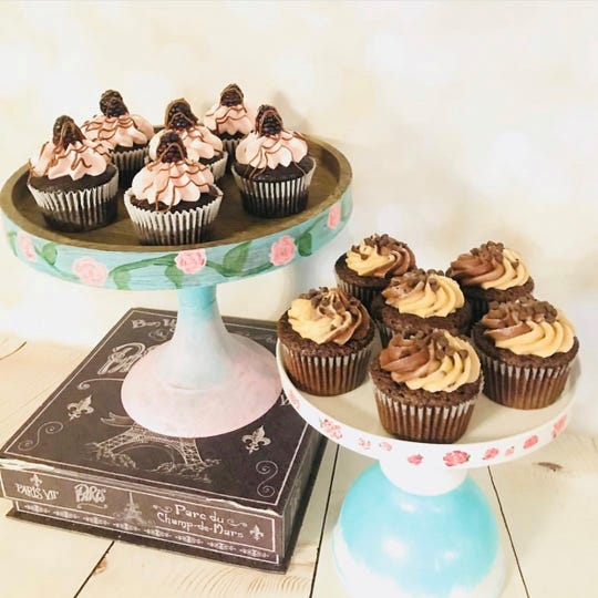 A variety of cupcakes by Nicole Conklin of Whipped Cupcakes is shown.