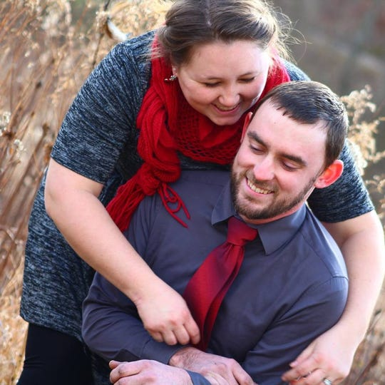 Olivia Cunningham, left, poses with her husband, Caleb Cunningham. Photo courtesy of Facebook.