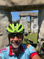 Day 21: Dave Watkins poses at Stonehenge II near Ingram, Texas. Watkins left San Diego, California, on March 31, 2019. He's biking cross-country to raise money for ovarian cancer research, after losing his wife and three other family members to the disease.