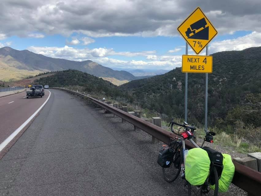 Day 7: A downhill 7 percent grade gives Dave Watkins a break in Arizona. Watkins left San Diego, California, on March 31, 2019. He's biking cross-country to raise money for ovarian cancer research, after losing his wife and three other family members to the disease.