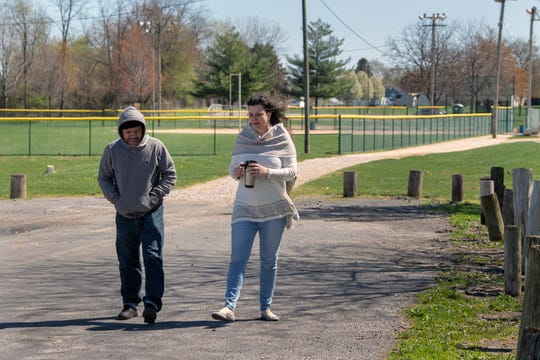 York residents William Padilla, left, walks with Tina Charles through Veterans Memorial Park in York. The two are hoping to find an area where a dirt bike park can be constructed to curtail illegal dirt bike riding in the city, much like the skate park that was established at Veterans Memorial Park years ago.