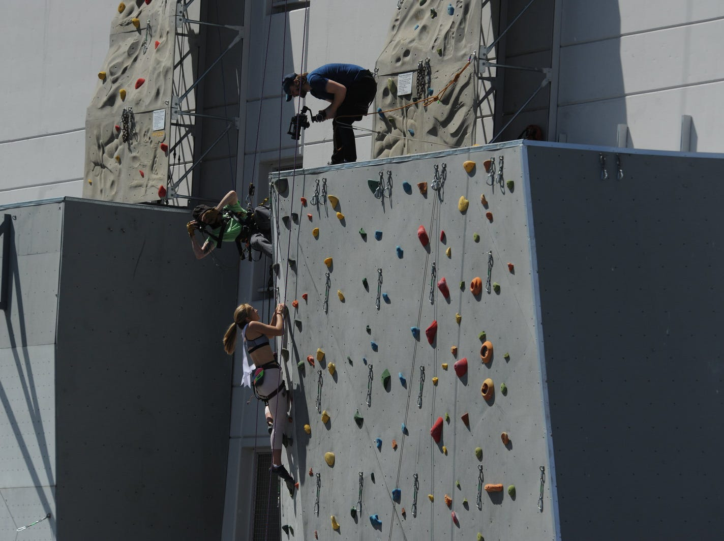 Miss USA contestants brave the heights while making their way up the Whitney Peak Hotel climbing wall at the BaseCamp Climbing Gym in Reno on April 23, 2019.