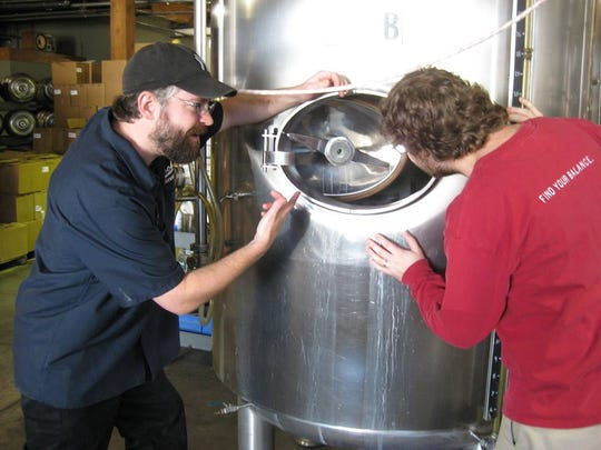 Josh LaGoy, left, helps his brother Mitch LaGoy at Rohrbach Brewing in 2010. Mitch worked as a brewer at Rohrbach and Josh would often lend a hand.
