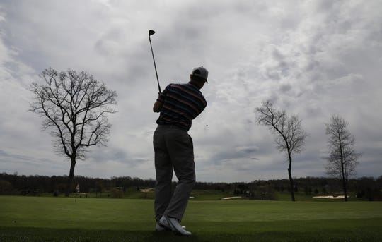 "Matt Duso of Fairport works on his chipping while waiting for a friend for a round at Ravenwood Golf Club Tuesday. Legislation has ben proposed that would evaluate golf course property taxes as ""real use"" in New York State."
