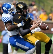 Drew Lock fumbles the ball as he is hit by Josh Allen. Both players are expected to be drafted in the first round.