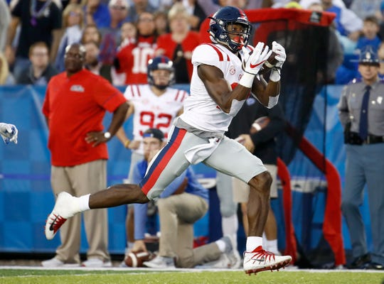 LEXINGTON, KY - NOVEMBER 04:  D.K. Metcalf #14 of the Mississippi Rebels catches a pass for a touchdown against the Kentucky Wildcats at Commonwealth Stadium on November 4, 2017 in Lexington, Kentucky.  (Photo by Andy Lyons/Getty Images)