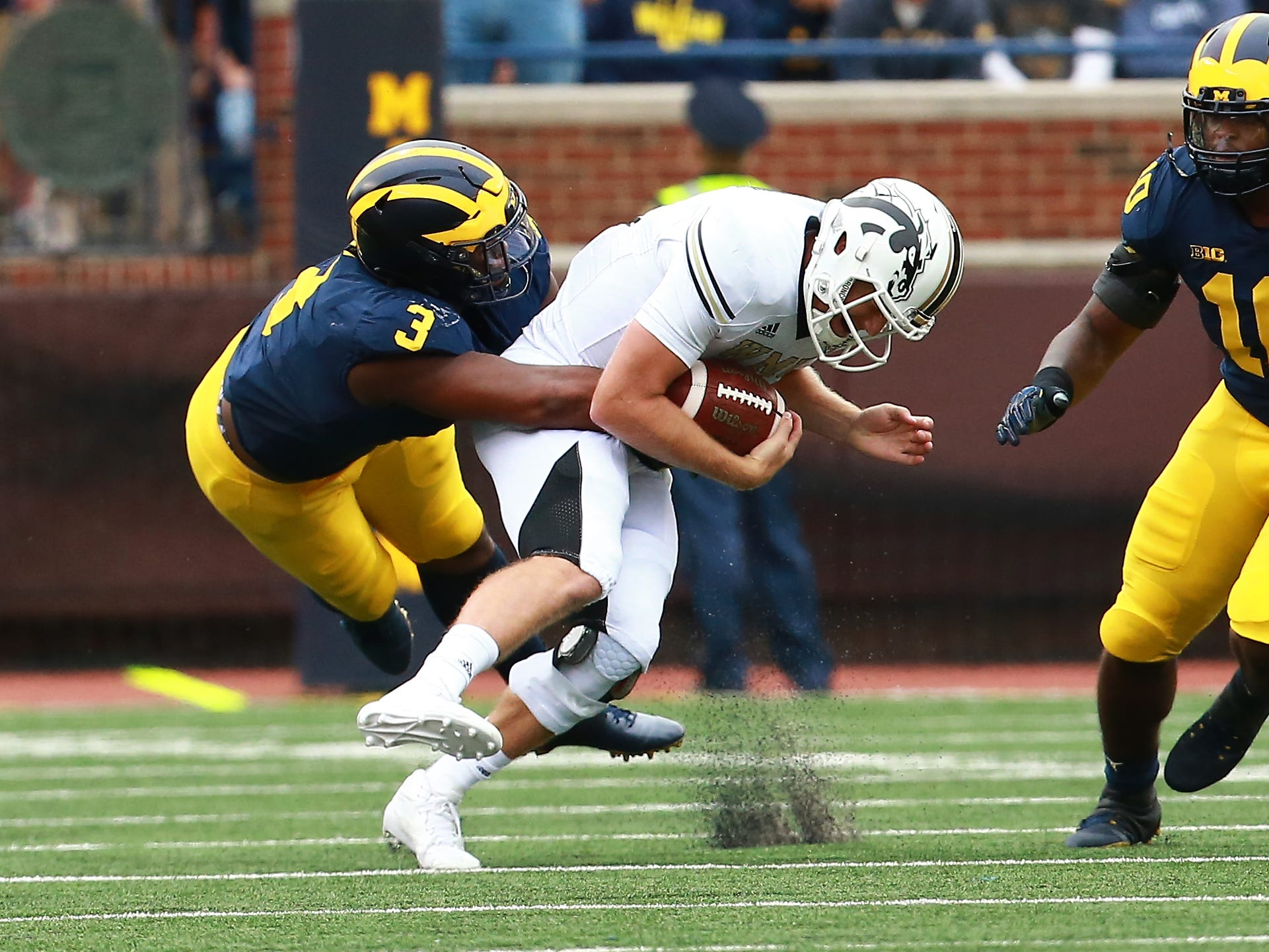 ANN ARBOR, MI - SEPTEMBER 08: Jon Wassink #16 of the Western Michigan Broncos runs the ball and is tackled by Rashan Gary #3 of the Michigan Wolverines in the second quarter at Michigan Stadium on September 8, 2018 in Ann Arbor, Michigan. (Photo by Rey Del Rio/Getty Images)