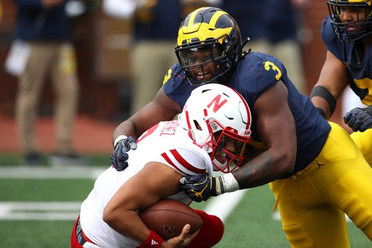 Rashan Gary of Michigan sacks Nebraska's Adrian Martinez during a September 2018 game.