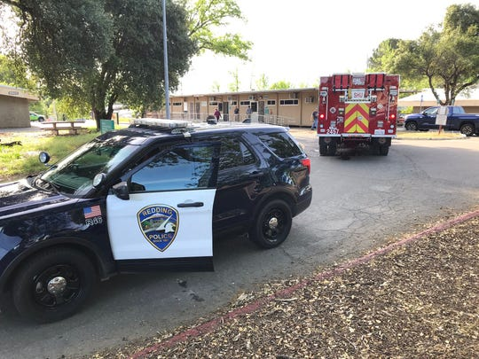 A Redding police car and a fire engine is seen in April 2019 on the Shasta College campus.