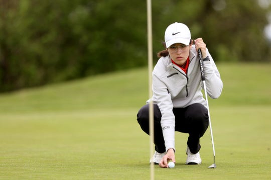 Sprague's Quincy Beyrouty lines up her putt in a Mountain Valley Conference league match at Cross Creek Golf Course near Dallas on April 23, 2019.