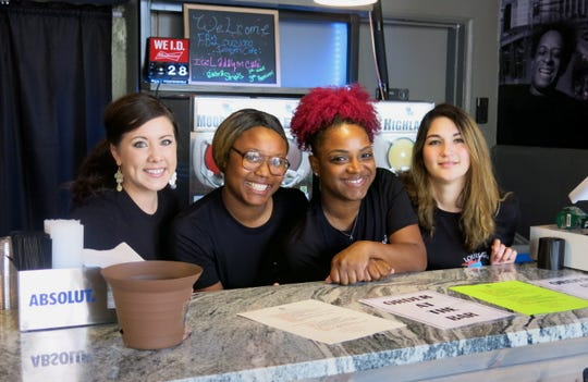 Bertenders serving celebrators at opening of the new Louisiana Daiquiri Cafe: Katherine Wilson, Brynishia Bogan, Cheayra Gordon, Brittany Morales.