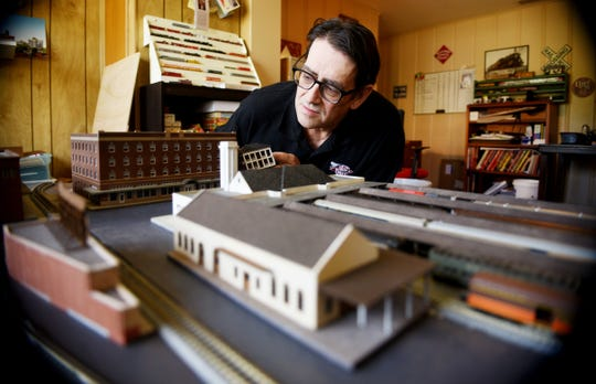 Russell Higginbotham and his models of Shreveport buildings.
