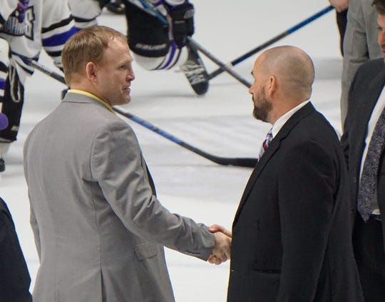 Lone Star head coach Dan Wildfong (left) and Mudbugs head coach Jason Campbell shake hands following Monday's Game 5 thriller.
