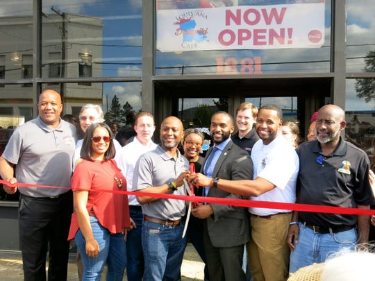 Let's cut the ribbon at the new Louisiana Daiquiri Cafe.