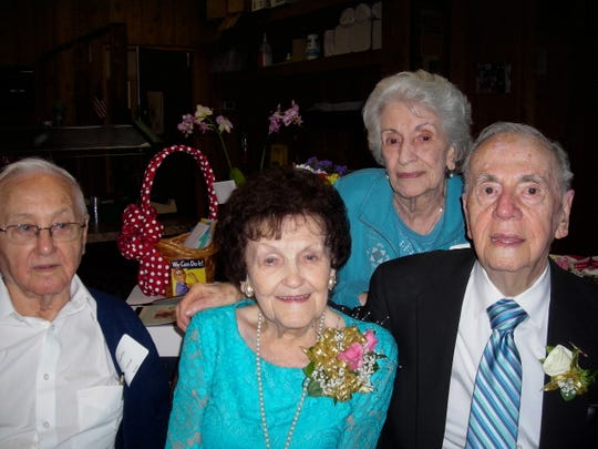 Stanley Kolniak, Estelle Notini, Julia Kolniak, Joseph Notini at a toast to Estelle's 100th birthday.