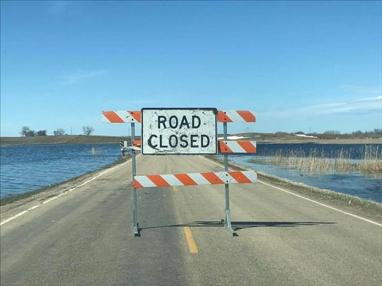 A road closed sign stands in Hamlin County, South Dakota as the area continues to flood in April 2019.