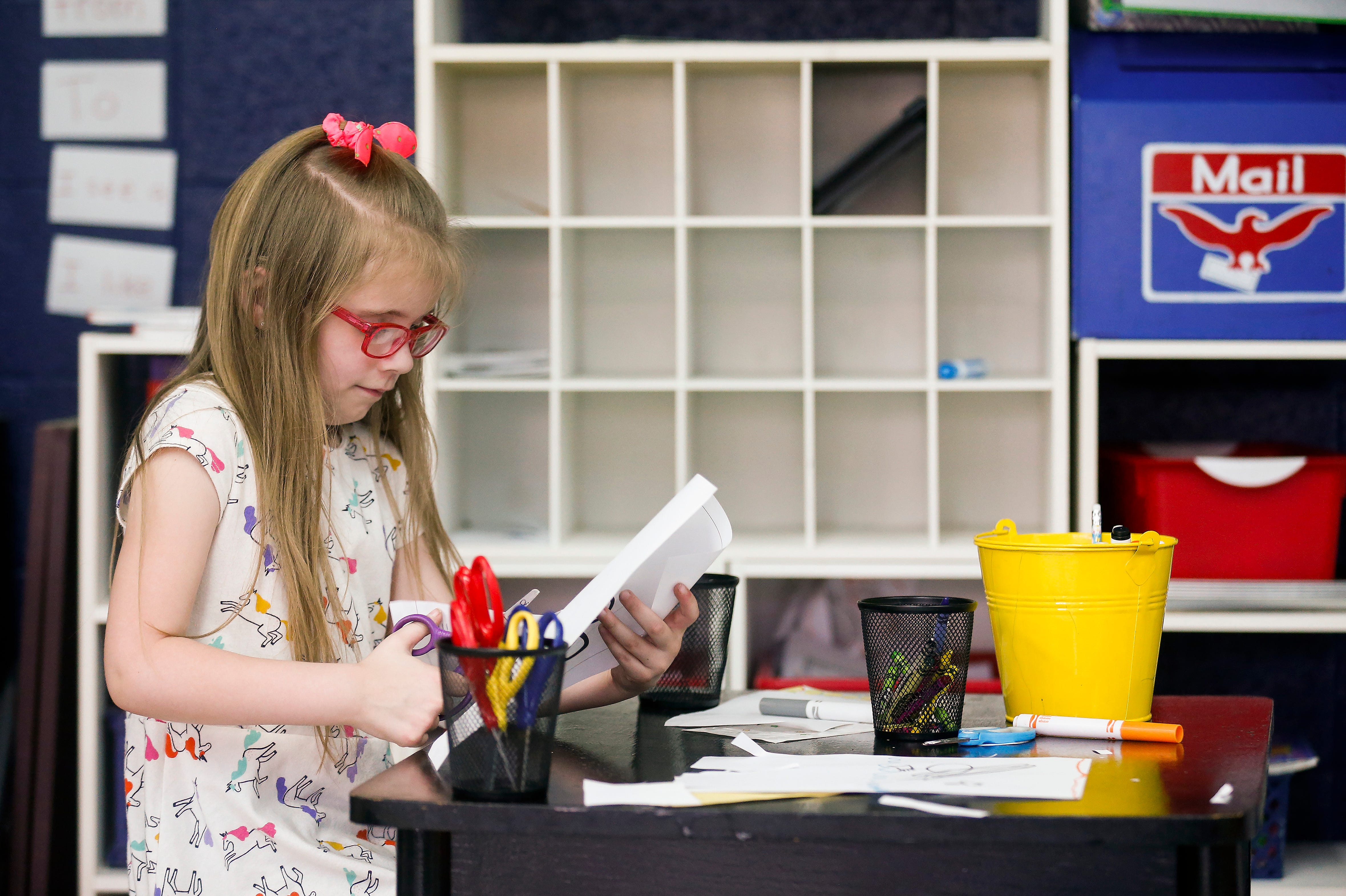Harley May works on a project in Michelle Pickett's kindergarten class at Cowden Elementary School on Tuesday, April 23, 2019.