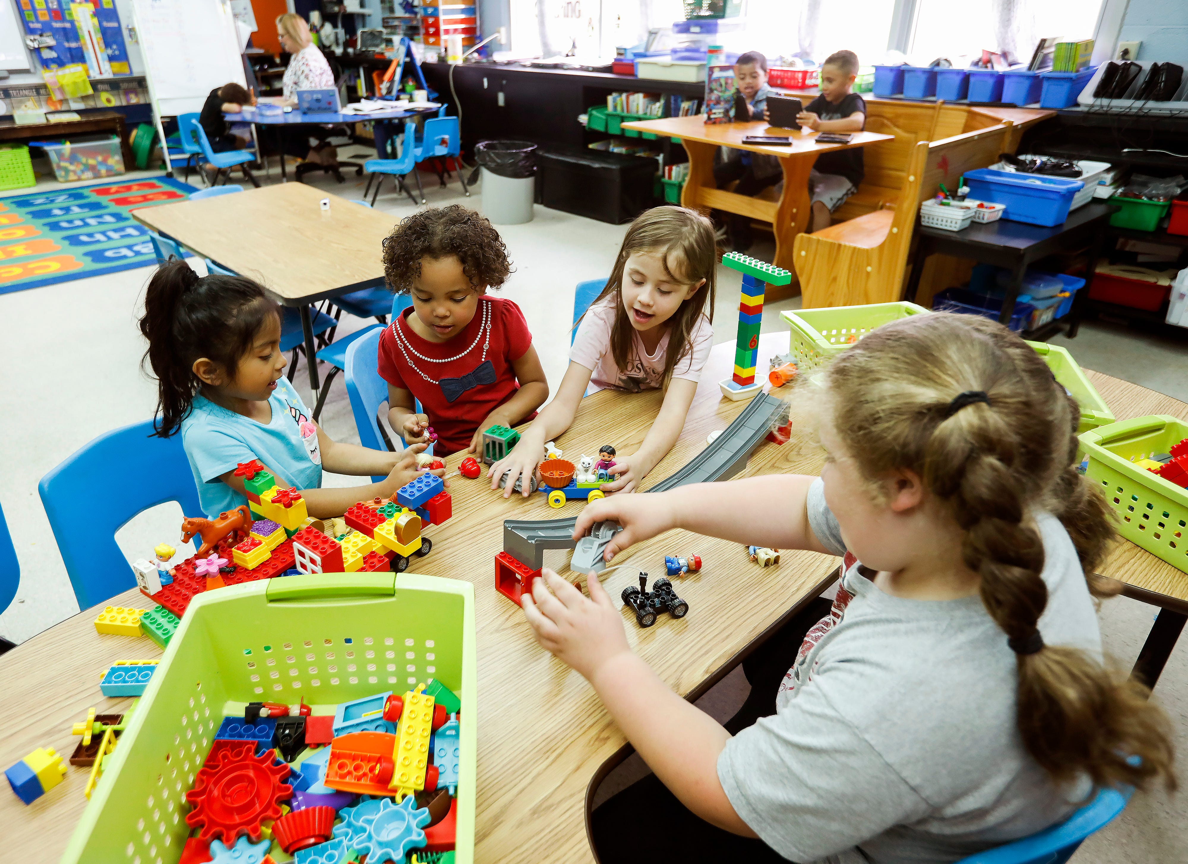 From left, Adriana Campos, Carla Gibson-Thompson, Taylor Richards, and Jaiden Robertson play with Legos in Michelle Pickett's kindergarten class at Cowden Elementary School on Tuesday, April 23, 2019.