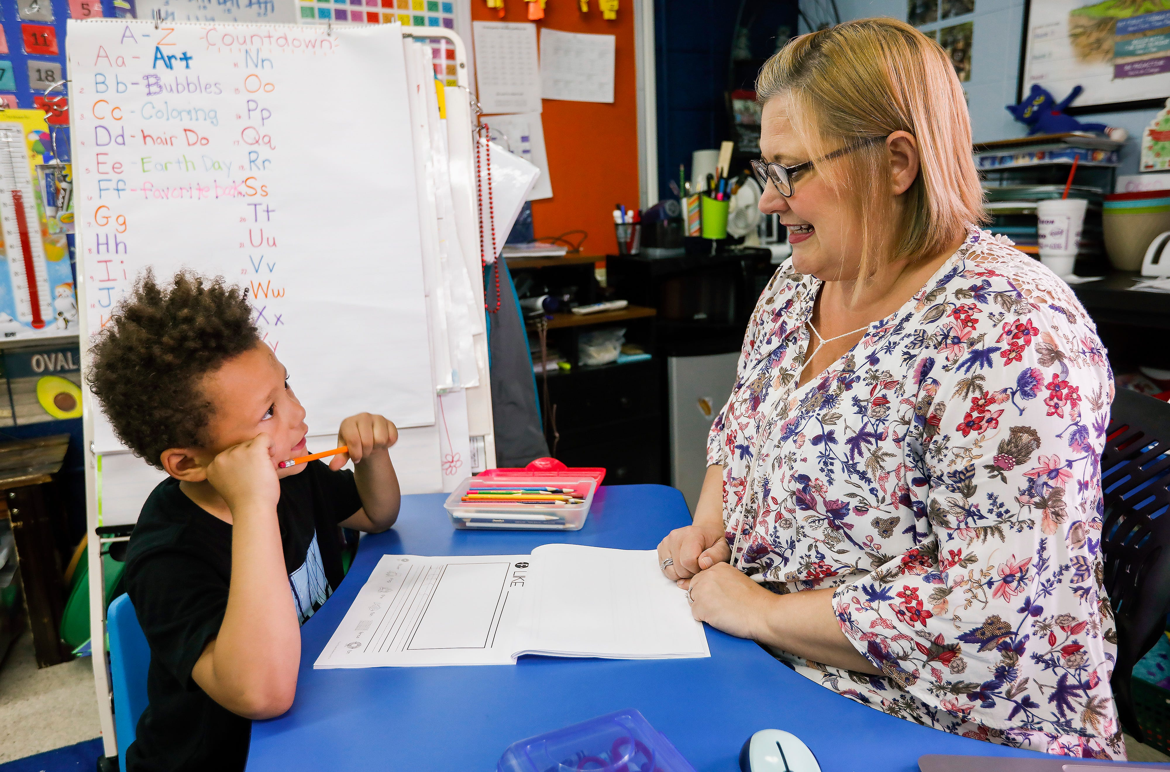 Michelle Pickett works with kindergartner Deacon Hazeltine, 6, on the A-Z countdown at Cowden Elementary School on Tuesday, April 23, 2019.