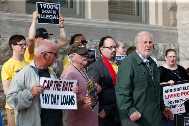Bob Perry, a member of Faith Voices of Southwest Missouri, speaks about payday loans outside Historic City Hall before a city council meeting on Monday, April 22, 2019.