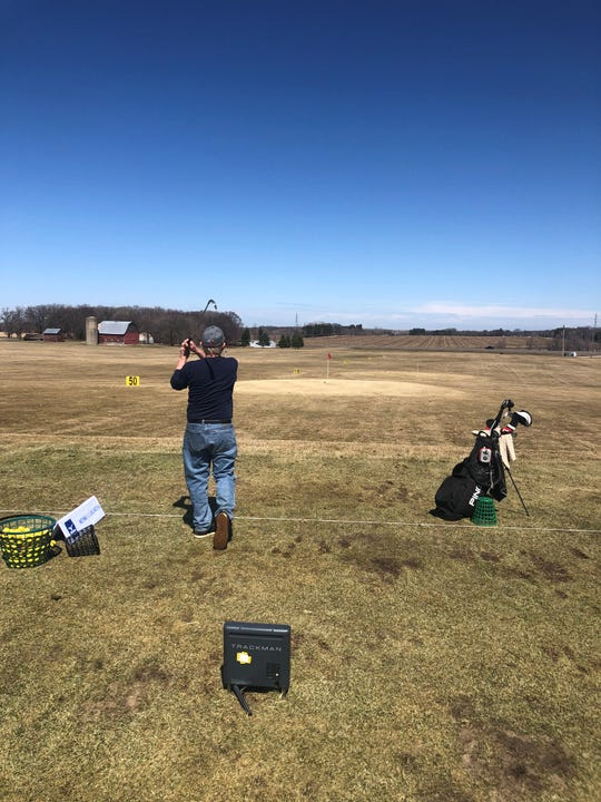 A golfers tries out the new equipment at Demo Day on April 20 at Territory Golf Club.