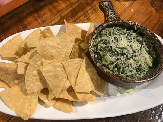 Guru's serves up spinach and artichoke dip with tortilla chips.