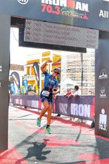 Melodie Carli crosses the finish line at the IRONMAN 70.3 Cartagena in Cartagena, Colombia on Dec. 3, 2017.