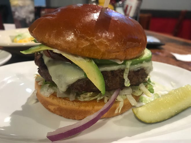 Guru's Sports Bar and Grill has an abundance of options, particularly sandwiches and burgers. Pictured is Guru's California Burger.