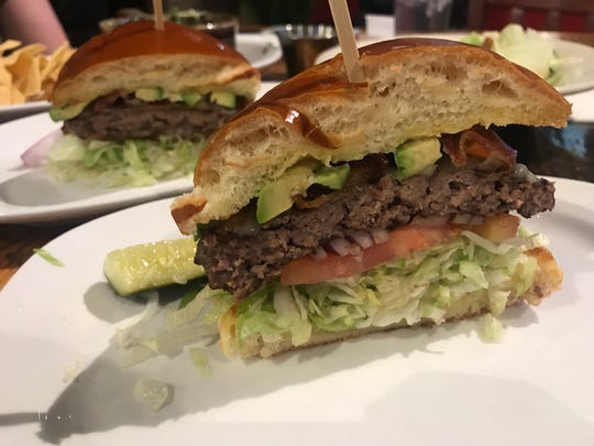 The California Burger at Guru's is a half-pound Angus beef patty topped with avocado, bacon, lettuce, tomato and onion.