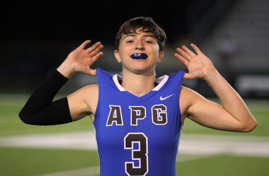 Godby senior Kaylene Colburn celebrates as Godby beat Florida High 22-12 in a flag football district semifinal on April 22, 2019.