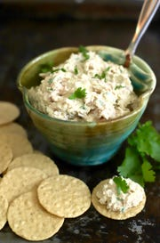 Deviled ham spread with cream cheese is tasty on crackers.
