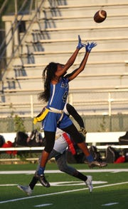 Godby senior Armarni Williams comes up with a deep-ball catch as Godby beat Florida High 22-12 in a flag football district semifinal on April 22, 2019.